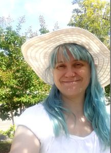 A few weeks ago, my hair had lightened to a lovely pastel blue. I often wear a hat outside on sunny days to keep it from fading faster.