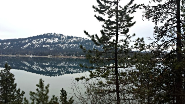 Evergreens, mountains, a mirror lake, and snow - what's not to love?