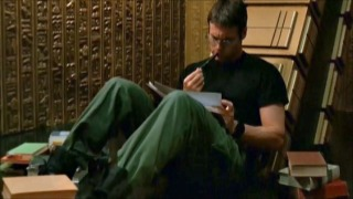 Daniel Jackson of Stargate: SG1 doing research. This is probably how the show's writers felt much of the time.